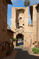 Medieval streets and gateway tower of of Assisi Italy