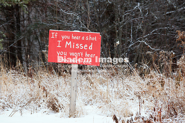 Property sign with a sense of humor - winter, Northern Minnesota.