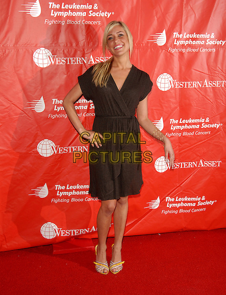 KRISTIN CAVALLERI.The 2nd Annual Celebrity Rock 'n Bowl presented by The Leukemia & Lymphoma Foundation held at The Lucky Strike Lanes in Hollywood, California, USA..April 6th, 2006.Ref: DVS.full length black dress wrap hand on hip.www.capitalpictures.com.sales@capitalpictures.com.Supplied By Capital PIctures
