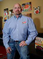 NWA Democrat-Gazette/DAVID GOTTSCHALK - 4/6/15 - Mark Henry, owner of Catering Unlimited, in his office in Springdale Monday April 6, 2015.