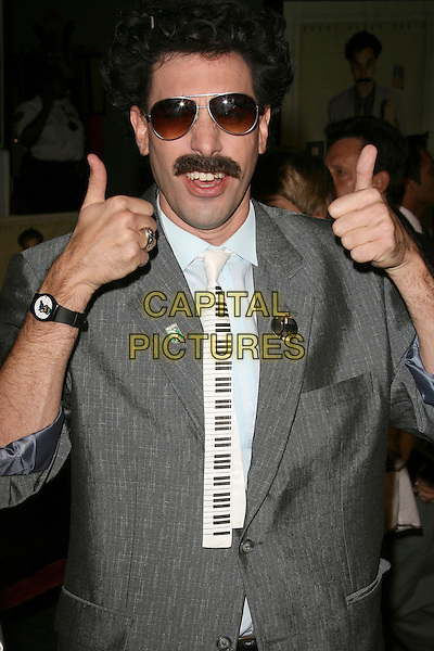 "SASHA BARON COHEN.""Borat: Cultural Learnings of America for Make Benefit Glorious Nation of Kazakhstan"" World Premiere - Arrivals held at Mann's Chinese Theatre, Hollywood, California, USA..October 23rd, 2006.Ref: ADM/ZL.half length grey gray suit jacket sunglasses shades mustache piano tie thumbs up.www.capitalpictures.com.sales@capitalpictures.com.©Zach Lipp/AdMedia/Capital Pictures."