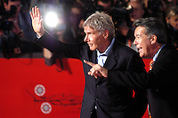 HARRISON FORD .arrives at the Patricia McQueeney Award Dinner Party Hosted By Vanity Fair on the eighth day of Rome Film Festival (Festa Internazionale di Roma) at the Etruscan Museum Valle Giulia, Rome, Italy, October 20th 2006..half length red carpet hand waving.Ref: CAV.www.capitalpictures.com.sales@capitalpictures.com.©Luca Cavallari/Capital Pictures.