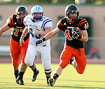 SIOUX FALLS, SD - SEPTEMBER 19: Logan Raabe #44 from Washington looks for running room past James Dethlefs #63 from Rapid City Stevens in the first quarter of their game Friday night at Howard Wood Field.  (Photo by Dave Eggen/Inertia)