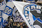 Home fans in the Ostkurve section of the stadium waving flags before Hertha Berlin's match against  Sporting Lisbon at the Olympic Stadium in Berlin in the group stages of the UEFA Europa League. Hertha won the match by 1 goal to nil to press to the knock-out round of the cup. 2009/10 was the the first year in which the Europa League replaced the UEFA Cup in European football competition.