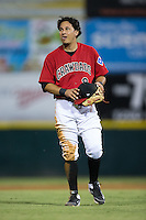 Edwin Garcia (9) of the Hickory Crawdads between innings of the game against the Charleston RiverDogs at L.P. Frans Stadium on August 25, 2015 in Hickory, North Carolina.  The Crawdads defeated the RiverDogs 7-4.  (Brian Westerholt/Four Seam Images)