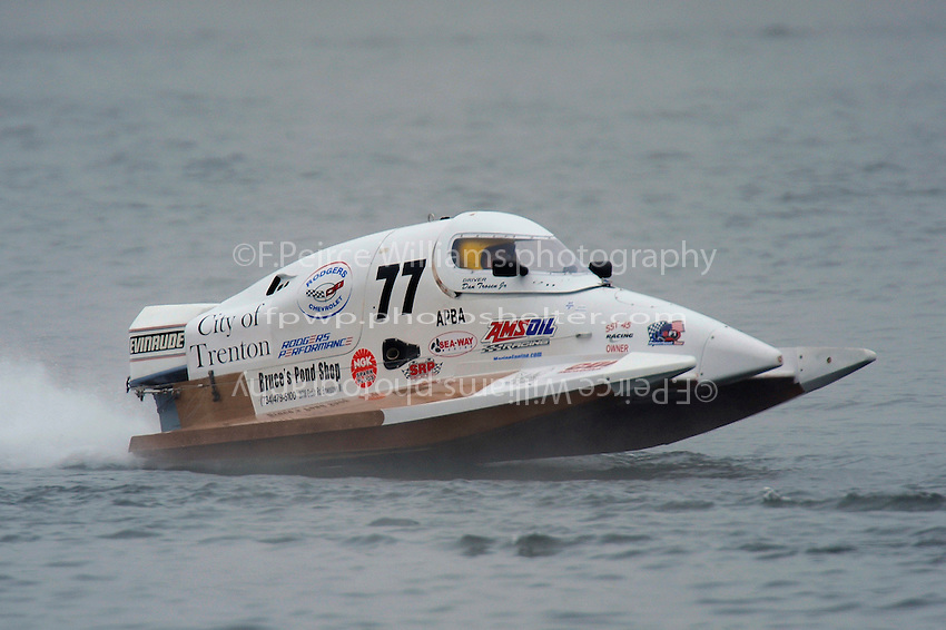 Dan Trosen, Jr., (#77) races through the fog….  (SST-45 class)