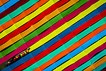 Huge strips of fabric create a rainbow of colour as they are laid out to dry.  One worker can be seen sitting on a small boat as she stretches out the hand-made material on a structure made over a lake.<br /> <br /> Workers at the fabric factory carefully align the traditional garments in straight rows to dry them under the hot sun for a day.  These aerial photographs were taken by a drone by amateur photographer Zay Yar Lin, 35, at Inle Lake, Myanmar.  SEE OUR COPY FOR DETAILS.<br /> <br /> Please byline: Zay Yar Lin/Solent News<br /> <br /> © Zay Yar Lin/Solent News & Photo Agency<br /> UK +44 (0) 2380 458800