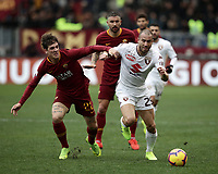 Football, Serie A: AS Roma - Torino, Olympic stadium, Rome, January 19, 2019. <br /> Roma's Nicol&ograve; Zaniolo (l) in action with Torino's Lorenzo De Silvestri (r) during the Italian Serie A football match between AS Roma and Torino at Olympic stadium in Rome, on January 19, 2019.<br /> UPDATE IMAGES PRESS/Isabella Bonotto