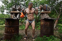 Game warden Sergei Shurunov lifts weights manufactured out of scrap metal at Kurilskoe Lake Preserve, a world heritage site with a serious poaching. <br /> Tikhon brought in a group of wardens from the Sochi area of Russia (Caucus mountains) so that they would have no local contacts or ties to poaching brigades and would clean up the area.