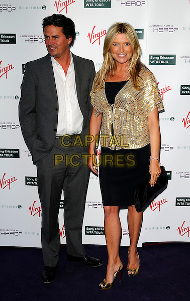 OLI WHEELER & TINA HOBLEY.The Pre-Wimbledon party, Roof Gardens, kensington, London, England..June 19th, 2008.full length grey gray suit black dress gold jacket married husband wife sequins sequined .CAP/CAN.©Can Nguyen/Capital Pictures.