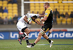 Garth April of the Sharks is tackled by Brad Shields of the Hurricanes during the Super Rugby quarter-finals match between the Sharks from South Africa and Wellington Hurricanes at Westpac Stadium in Wellington on July 23, 2016. Photo: Martin Hunter / lintottphoto.co.nz