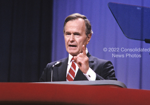 United States Vice President George H.W. Bush on the podium as he delivers his speech accepting his party's nomination for President of the United States at the 1988 Republican Convention at the Super Dome in New Orleans, Louisiana on August 18, 1988.<br /> Credit: Howard L. Sachs / CNP