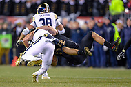 PHILADELPHIA, PA - DEC 8, 2018: Army Black Knights linebacker Cole Christiansen (54) tackles Navy Midshipmen quarterback Garret Lewis (7) in the back field during game between Army and Navy at Lincoln Financial Field in Philadelphia, PA. Army defeated Navy 17-10 to win the Commander in Chief Cup. (Photo by Phil Peters/Media Images International)