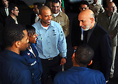 Gulf of Oman - December 11, 2008 -- President Hamid Karzai of Afghanistan addresses Sailors Thursday, December 11, 2008 in the hangar bay of the Nimitz-class aircraft carrier USS Theodore Roosevelt (CVN 71). Karzai visited Theodore Roosevelt to gain a better understanding of how the United States Navy conducts operations at sea. Theodore Roosevelt and embarked Carrier Air Wing (CVW) 8 are deployed to the U.S. 5th Fleet area of responsibility. .Credit: Antwjuan Richards-Jamison - U.S. Navy via CNP