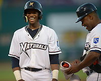 NWA Democrat-Gazette/ANDY SHUPE<br /> Northwest Arkansas Naturals left fielder Khalil Lee (left) laughs alongside hitting coach Leon Roberts after hitting an RBI single to score designated hitter Anderson Miller against the Tulsa Drillers Wednesday, July 11, 2018, during the fourth inning at Arvest Ballpark in Springdale. Visit nwadg.com/photos to see more photographs from the game.