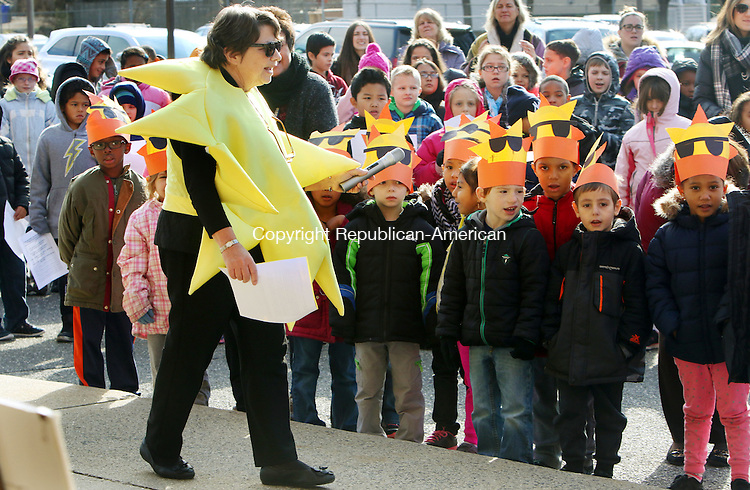 TORRINGTON CT. 24 November 2015-112415SV04-Joanne Creedon, principal dressed as a sun to celebrate the dedicated of the solar panels at Forbes School in Torrington Tuesday. The school had a dedicated ceremony outside the school with local officials. The school was the first in the city to have solar panels installed on its roof and one on its wall to generate clean energy and reduce utility expenses. <br /> Steven Valenti Republican-American