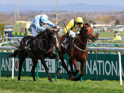 14h April 2018, Aintree Racecourse, Liverpool, England; The 2018 Grand National horse racing festival sponsored by Randox Health, day 3; Black Op ridden by Noel Fehily (on the left) comes comes through to beat Lostintranslation ridden by Robbie Power in The Betway Mersey Novices' Hurdle