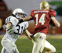 Taking The Bull By The Horns.  FSU's Matt Henshaw, with his hand pushing against Penn State's Paul Posluszny's face mask, attempts to pick up extra yardage after receiving a Drew Weatherford pass in the third quarter of the 2006 FedEx Orange Bowl Game.  Henshaw managed to pick up six yards on the catch before Posluszny, winner of awards for the nation's best defensive player and top linebacker, brought him down.