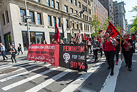 New York, NY 1 May 2017 - Socialists, dressed in red, march up University Place, from Washington Square to Union Square, fto the May Day rally for Inernational Workers Day in Union Square Park. ©Stacy Walsh Rosenstock/Alamy Live News