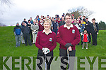 CHEERING: A large crowd cheer on Una Fitzgerald (Lady Captain) and Captain Larry Daly at the Captains drive in at Dunloe Golf course last Sunday morning. .