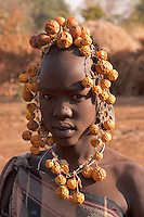 Mursi girl portrait in Omo valley Ethiopia