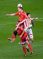 MELBOURNE, AUSTRALIA - NOVEMBER 14: Matthew Smith of the Roar wins the ball during the round 14 A-League match between the Melbourne Heart and Brisbane Roar at AAMI Park on November 14, 2010 in Melbourne, Australia (Photo by Sydney Low / Asterisk Images)