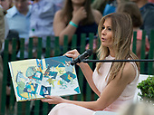 "First lady Melania Trump reads ""Party Animals"" by Kathie Lee Gifford to a group of children as she and United States President Donald J. Trump host the annual Easter Egg Roll on the South Lawn of the White House in Washington, DC on Monday, April 17, 2017.<br /> Credit: Ron Sachs / CNP"