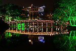 Bridge At Night - Wooden bridge to the Ngoc Son Temple reflected in Hoan Kiem Lake at night, Hanoi, Vietnam