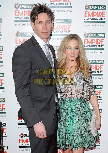 guest & Froggatt.Jameson Empire Film Awards at the Grosvenor House Hotel, Park Lane, London, England..March 25th 2012.half length green grey gray black print skirt top dress clutch bag white black suit.CAP/BF.©Bob Fidgeon/Capital Pictures.