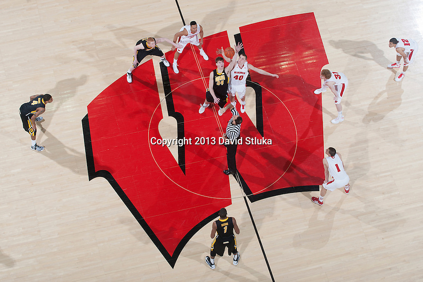 An overhead view of the opening tipoff of the Wisconsin Badgers Big Ten Conference NCAA college basketball game against the Iowa Hawkeyes Wednesday, February 6, 2013, in Madison, Wis. The Badgers won 74-70 (2OT). (Photo by David Stluka)