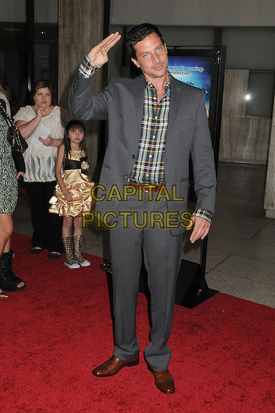 "Simon Rex.Attending the ""Scary Movie 5"" Los Angeles film premiere held at the Cinerama Dome,  Hollywood, California, USA, .11th April 2013..full length salute gesture suit  grey grey shirt plaid checked jacket .CAP/ADM/BP.©Byron Purvis/AdMedia/Capital Pictures"
