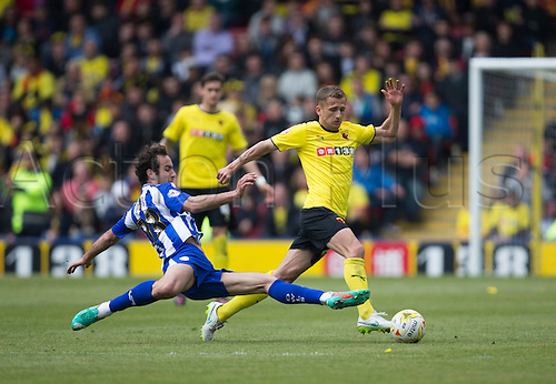 02.05.2015.  Watford, England. Skybet Championship. Watford versus Sheffield Wednesday. Sheffield Wednesday's Filipe Melo attempts the challenge on Watford's Matěj Vydra.