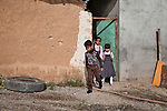 18/04/15. Goktapa, Iraq. Dhuha going to school with her brother Ali and her friend Heshw