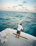 USA, Florida, fisherman on the Fish Tales casting a net, elevated view, Islamorada
