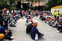 """Rome April 30 2006  .Piazza Vittorio  .Sikh """"Punj Pyare"""" (Five Beloved Ones) lead a religious parade.The parade is for Visaki, a traditional Sikh celebration..The lunch."""