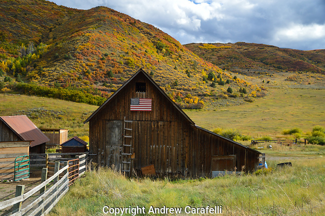 An old barn near Snowmass, Colorado proudly displays the American flag.