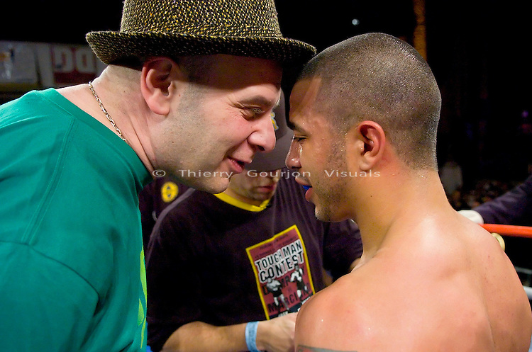 Gary Stark Jr. (r ) is congratulated by his promoter Lou DiBella after his  NY State Junior Featherweight Championship fight against  Vernie Torres at the Manhattan Center in N.Y.C on 12.14.06..Stark won by Unanimous decision.<br />