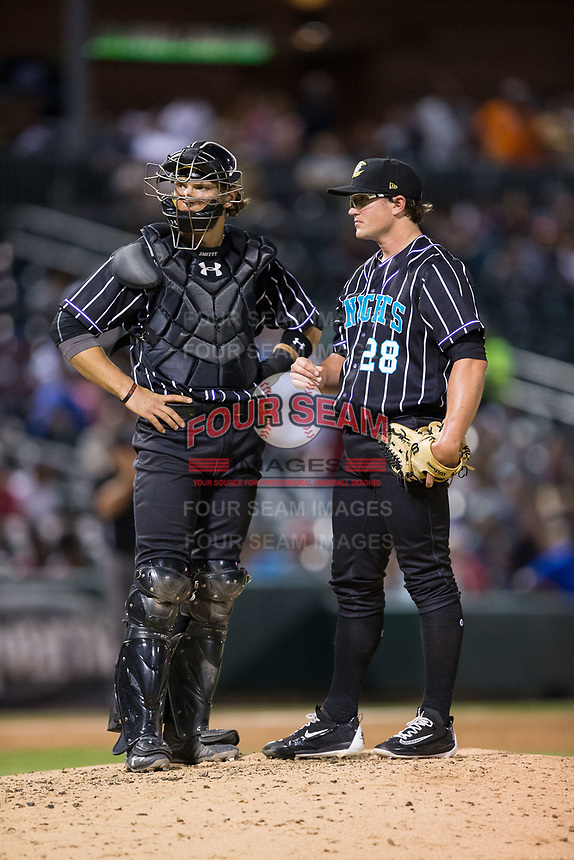 Charlotte Knights catcher Kevan Smith (32) meets with starting pitcher Carson Fulmer (28) on the mound during the game against the Norfolk Tides at BB&T BallPark on May 2, 2017 in Charlotte, North Carolina.  The Knights defeated the Tides 8-3.  (Brian Westerholt/Four Seam Images)