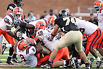 2 September 2006: Wake Forest's Micah Andrews (3) fights for extra yards against the Syracuse defense. Wake Forest defeated Syracuse 20-10 at Groves Stadium in Winston-Salem, North Carolina in an NCAA college football game.