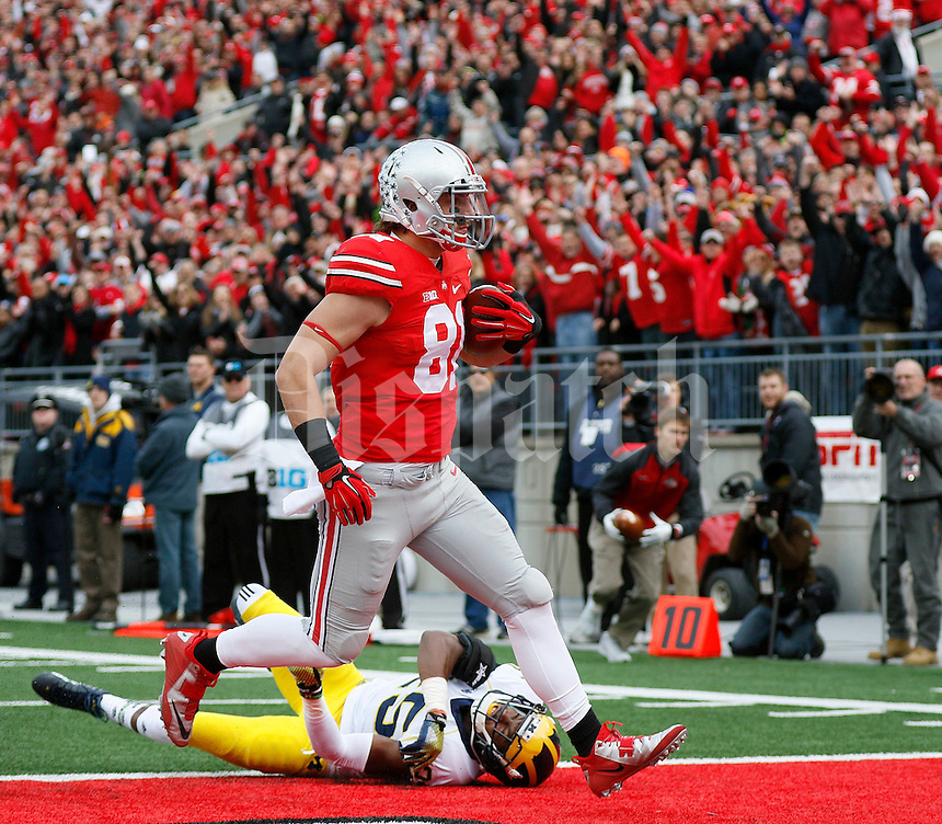 Ohio State Buckeyes tight end Nick Vannett (81) scores a touchdown past Michigan Wolverines defensive back Dymonte Thomas (25) during the first quarter of the NCAA football game against Michigan at Ohio Stadium on Saturday, November 29, 2014. (Columbus Dispatch photo by Jonathan Quilter)