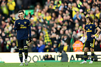 1st December 2019; Carrow Road, Norwich, Norfolk, England, English Premier League Football, Norwich versus Arsenal; A dejected David Luiz and Mesut Ozil of Arsenal as Todd Cantwell of Norwich City scores for 2-1 - Strictly Editorial Use Only. No use with unauthorized audio, video, data, fixture lists, club/league logos or 'live' services. Online in-match use limited to 120 images, no video emulation. No use in betting, games or single club/league/player publications