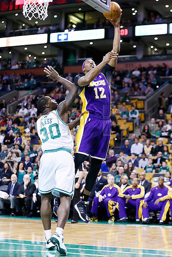 07.02.2013. Boston, Mass.  Los Angeles Lakers center Dwight Howard (12) goes for the layup past Boston Celtics power forward Brandon Bass (30) during the Boston Celtics 116-95 victory over the Los Angeles Lakers at the TD Garden, Boston, Massachusetts, USA.
