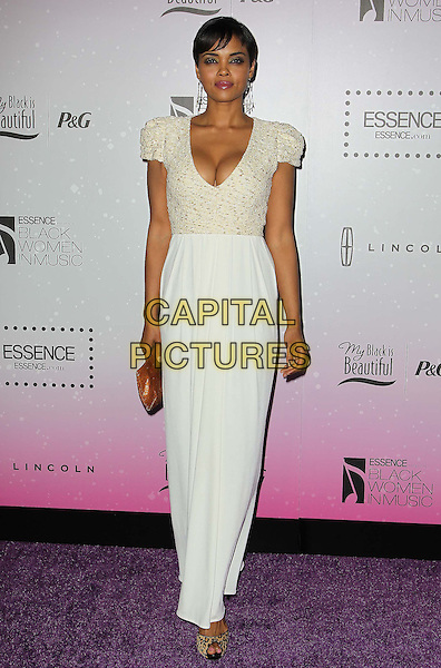 Sharon Leal.4th Annual ESSENCE Black Women In Music held at Greystone Manor Supperclub, West Hollywood, California, USA..February 6th, 2013.full length white dress clutch bag lace brown cleavage .CAP/ADM/KB.©Kevan Brooks/AdMedia/Capital Pictures.