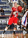Nicholls State University Colonels forward Cassie Hearon (31) passes the ball in the game between the UTA Mavericks and the  Nicholls State University Colonels  held at the University of Texas in Arlington's Texas Hall in Arlington, Texas. UTA defeats Nicholls 69 to 62