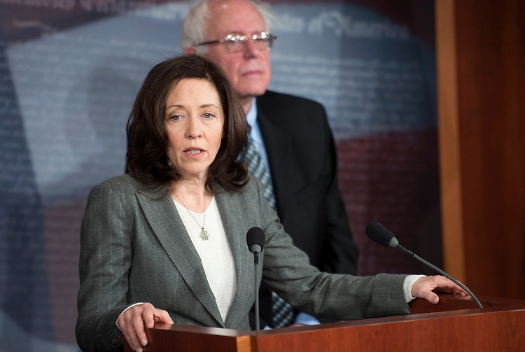 "UNITED STATES - DECEMBER 6:  Sen. Maria Cantwell, D-Wash.; and Sen. Bernie Sanders, I-Vt., hold a news conference on ""efforts to stop a Federal Communications Commission proposal that would weaken rules on cross ownership of newspapers, television and radio stations in the same media markets."" (Photo By Chris Maddaloni/CQ Roll Call)"