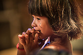 A young Kamayura child watches a cultural presentation at the first ever International Indigenous Games, in the city of Palmas, Tocantins State, Brazil. The games will start officially with an opening ceremony on Friday the 23rd October. Photo © Sue Cunningham, pictures@scphotographic.com 21st October 2015