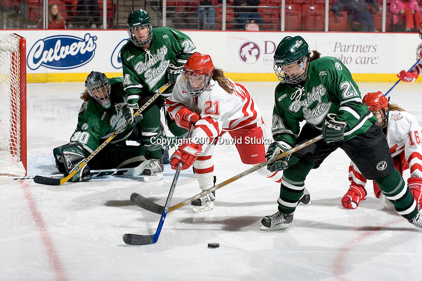 MADISON, WI - FEBRUARY 16: Angie Keseley #21 of the Wisconsin Badgers women's hockey team battles for the puck against the Bemidji State Beavers at the Kohl Center on February 16, 2007 in Madison, Wisconsin. The Badgers beat the Beavers 2-0. (Photo by David Stluka)
