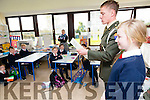 Irish defence forces  Lt Denis Sheahan with help from Niamh Vivier 6th class to read out part of the proclamation at  Ballincrossig National School in Ballyduff, when he visited the school on Thursday to present the Irish Tri Colour and proclamation