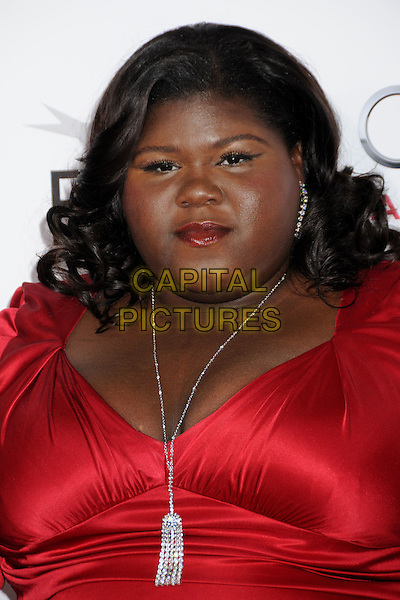 "GABOUREY ""GABBY"" SIDIBE.2009 AFI Film Festival Premiere of ""Precious"" held at Grauman's Chinese Theatre, Hollywood, California, USA,.1st November 2009..portrait headshot red  silver necklace smiling .CAP/ADM/BP.©Byron Purvis/Admedia/Capital Pictures"