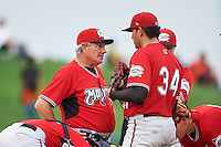 Carolina Mudcats manager Rocket Wheeler (18) talks with pitcher Enderson Franco (34) during a game against the Frederick Keys on June 4, 2016 at Nymeo Field at Harry Grove Stadium in Frederick, Maryland.  Frederick defeated Carolina 5-4 in eleven innings.  (Mike Janes/Four Seam Images)
